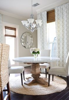 Round Dining Room Table. Dining room Marble top table Chairs Drapes Round rug Love the benches mixed with chairs  Fun idea for a round