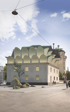 The design of the roof extension is informed by nearby buildings and art nouveau styles.