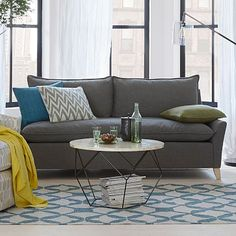 In the hunt for a new sofa.  Love this combo of mid century modern, single lower cushion, and color. Bliss Down-Filled Sofa