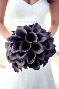 This beautiful bridal bouquet features elegant deep purple calla lilies,
