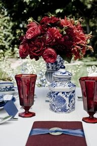 Chinoiserie Blue with red blooms and glassware.