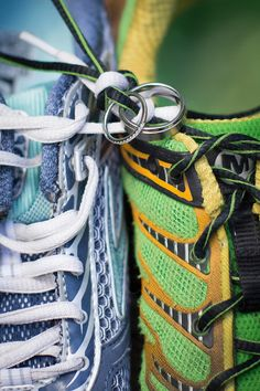 Our photographer tied our wedding rings to our running shoes. #running #wedding #runningwedding