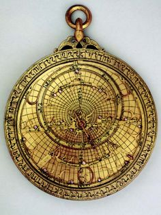 Astrolabe with Universal Plate and Astrological Plates of Ahmad ibn Husayn ibn Bãso. 16.5 cm brass. Nasrid period 1304-5.
