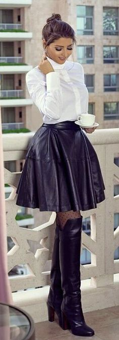 ❤ LOVE her skater skirt in leather and such a narrow waist!