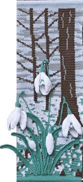 Die Wandbehänge wurden im Jaquardmuster gehäkelt.  Für die Blüten benutzt man Blumendraht und Wattierung, um einen 3D-Effekt entstehen zu lassen.