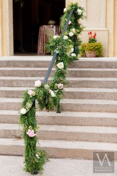 This verdant garland creates such a sweet entrance    Bella Collina Weddings