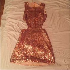 Rose gold sequin dress Bought from another posher who listed the dress as a size small but it's actually an xs... Way too tight on me... Previous posher only wore it once and I've never worn it.. Absolutely love this dress wish it fit! No flaws! Tobi Dresses Mini