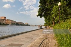 People walk along a Pushkinskaya Embankment, located in Gorky Park, Moscow, Russia.