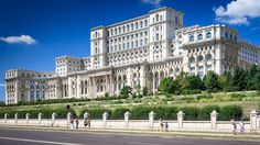 Palace of the parliament in Bucharest serves as a symbol for Romania since it is the second biggest building in the world. Udaipur, Palazzo, Palace Of The Parliament, Circular Buildings, Cities, Big Building, National Stadium, Bucharest Romania, Capital City
