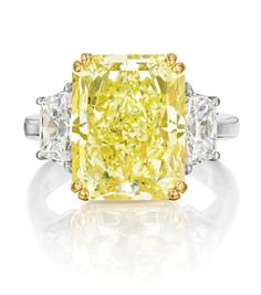 This yellow diamond ring by Cartier centers a magnificent rectangular-cut fancy yellow diamond weighing a whopping 9.55 carats. Would you say yes?? (Via Phillips.)