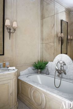 The guest bath's vanity, tub surround, and paneling are faux marble.