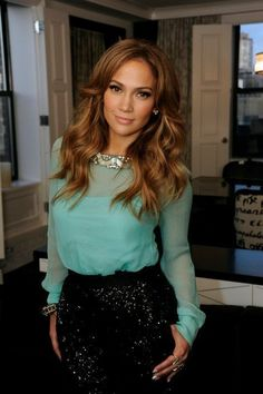 Transition that perfect summer turquoise blouse into fall by pairing it with a sparkly black skirt like J-Lo. ---40WinksADay