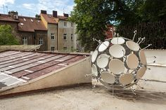 jakub geltner nests security cameras + satellite dishes in nature and architecture Sea Sculpture, Satellite Dish, Urban Landscape, Security Camera, Prague, Seaside, Facade, Weird, Dishes