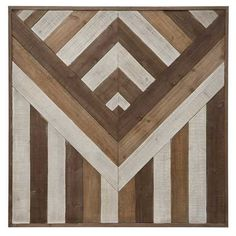 Blending modern style with traditional elements this pieced wood wall hanging was right at home in the informal den on the s3e6 Barndominium makeover