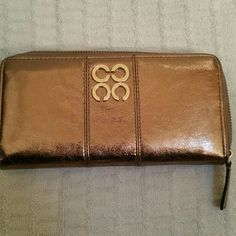 Authentic Coach wallet Coach gold leather zip around wallet with plenty of slots for cards and receipts, zipper section inside for change and slot pocket on the back of wallet. No stains rips or tears. Matching tote bag listed in closet  as well. Will do bundle deal for both bag and wallet, just ask. Coach Bags Wallets