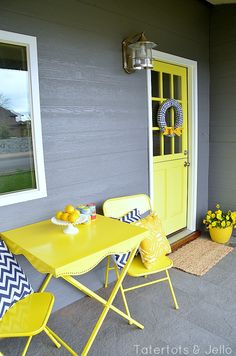 tatertots and jello cottage porch love that yellow dutch door & the bistro set painted to match the door! Maybe not the yellow door but grey and yellow EVERYTHING! Yellow Front Doors, Front Door Colors, Front Porch Makeover, Cottage Porch, Building A Porch, Diy Porch, Porch Ideas, House With Porch, Bistro Set