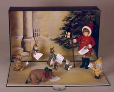 "RJW - Winnie-the-Pooh's Christmas Holiday. Three dimensional display diorama includes: an 11"" Christopher Robin dressed in all-felt winter costume with pole lantern; 5"" Pooh with felt muffler and boots; Piglet with coat and scarf; Eeyore with felt wreath; Kanga with felt shawl; Roo with scarf; Rabbit with scarf; Owl. All carry miniature sheet music. These items are posed in upon a hand painted background. 20"" high, 28"" wide, 26"" deep One-of-a-kind."