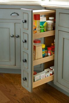 traditional kitchen cabinets by Heartwood Kitchen and Bath Cabinetry.  Pullout pantries again offer the convenience of bringing the stored items into view and to you.