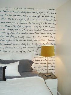 Starch: Amber of Numbered Street Designs shows the result of using starch paste to fasten lightweight fabric to a bedroom wall. Instructions included. Tape: This is about as easy as it gets: Using double-stick and painters tape, Christiana hung a single sheet of paper in her bedroom.