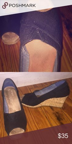 ToMs black canvas wedge Size 6 toms black canvas peep toe wedge. So cute! Cork wedge, black canvas, in good condition. Bought last year, worn less than a dozen times. Super comfy. Runs a little big. 6-61/2 would fit in this shoe TOMS Shoes Wedges