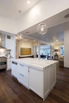 A Statuario Marble island bench becomes a feature in this beautiful home. Statuario Marble, Marble Island, Island Bench, Stone Kitchen, White Marble, Natural Stones, Beautiful Homes, Kitchen Design, Kitchens