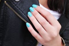 tiffany blue nails with a black leather jacket.