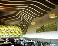 SO Architecture patterned the Rosso Restaurant's unusual undulating ceiling after the natural geography found in the northern part of Israel. Matched with cool green hues on the walls and bold black-and-white furnishings, the space is truly striking.