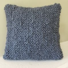 French Knots made with bulky yarn create a pillow that is plush and textural.