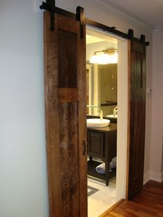 if there's no room on the wall for a full door, cut it in half; Barn Door Shower…