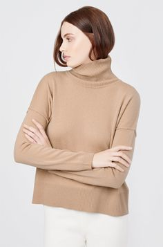 A sumptuous wool-cashmere turtleneck makes an elegant addition to our beloved collection of knits. The subtly cropped design is finished with exposed seams and dropped shoulders for a gorgeous, subtle statement. Crafted in Italy, it promises a cozy-chic look and soft, indulgent feel.