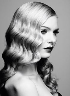 Classic Hollywood waves and curls created with a thermal curling iron
