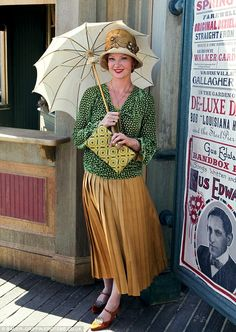 Gretchen Mol poses with her parasol between takes Boardwalk Empire. (so cool that she played Bettie Page in the biopic!)