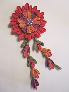 Fabric Kanzashi flowers traditionally worn in the hair but would make a beautiful brooch also.