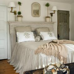 mantle headboard, love the bedding and sconces.