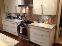 Applad White Ikea Kitchen. Also LOVE the grey small tile