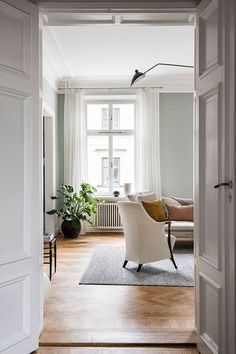 Just look at this magnificent olive shade of the walls of a spacious apartment in Stockholm - the color fits perfectly into the modern classic design of ✌Pufikhomes - source of home inspiration Beautiful Interiors, Modern Classic, Stockholm, New Homes, Living Room, Space, Interior Design, Interiors Online, Color