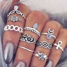 Channel your inner Boho chic with this vintage-style ring set. Featuring popular Bohemian symbols, these will transform your look to a gypsy-inspired ensemble. Choose between silver and gold to match