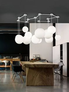 The brilliant white of this atomic ceiling fixture stands in stark contrast to the charcoal ceiling making it the star of the room   The Fifth Wall