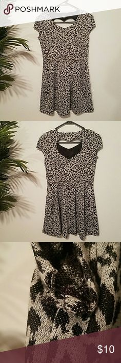BCX Girl Snow Leopard Print Heart Cutout Dress Adorable BCXgirl midi dress.?Heart shaped cut out in back?2 small tears in the left armpit, 1 in the right, price reflects and otherwise in great condition! BCX Dresses Midi
