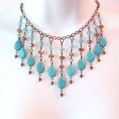Turquoise Bib Necklace - Bronze Wire Work - Amber Crystal Rondelles - Howlite Turquoise Teardrops on Etsy, $60.00