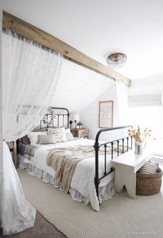 Modern farmhouse style combines the traditional with the new for a peaceful, airy, welcoming feel. Here are fifty farmhouse bedroom photos to inspire you.