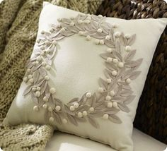 "DIY Pottery Barn Pillow. I love this wreath because my name (Lauren) means ""crowned with victory"" and it refers to crowns made of laurel leaves the Greeks would adorn themselves with upon special achievements and victories."