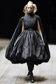 9. Alexander McQueen Fall/Winter 2006- Similar to the full/pleated sleeves of a herigaut, with a slit cut to allow the arms fit through