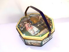 Vintage Sunshine Biscuit Tin W Lid And Handle Historical Patriotic Scenes Liberty Bell Some Wear And Aging 9.5 Inches Wide X 3.5 Inches Tall