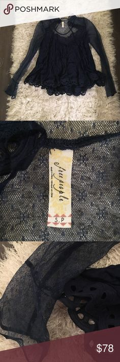 """Free People NWOT lace Victorian style top Never worn, too small for me! Gorgeous lace details .. You can tie the strings on the side of the shirt into a bow or leave them hanging, if tied it would resemble the """"bow choker"""" look. This stop is navy & beautiful  make an offer! Free People Tops"""