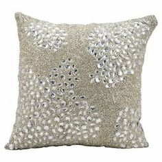 Handcrafted pillow with a rhinestone and bead-encrusted design.   Product: PillowConstruction Material: 100% Polyester cover and polystyrene bead fillColor: SilverFeatures:  Insert includedMade in India Cleaning and Care: Spot clean with warm water and mild soap