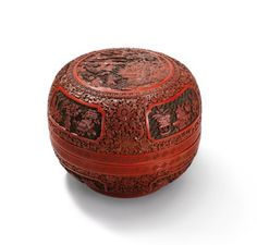 A CARVED THREE-COLOUR LACQUER 'DAOIST IMMORTALS BIRTHDAY' CIRCULAR BOX AND COVER QIANLONG PERIOD (1736-1795)