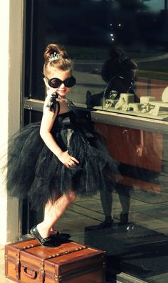 Adorable little girl rocking some serious swag, peeking at the jewelry in her Audrey Hepburn Breakfast at Tiffany's dress-up costume! Dress is THE ORIGINAL Mini Audrey Hepburn Tutu Dress by Atutudes! Find it here http://www.etsy.com/listing/83095941/breakfast-at-tiffanys-tutu-dress-by