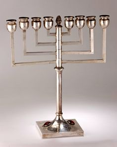 "The menorah was a gift to Davis from the New York Federation and bears the inscription ""Women's Division Jewish Philanthropies, Tuesday, November 23, 1965, Hotel Astor. To Sammy Davis, Jr., whose achievements, won by courage and integrity, say to every man, 'Yes, We Can.'"""