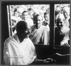 Life in Pictures :Gandhi interacting with his followers sitting in a train